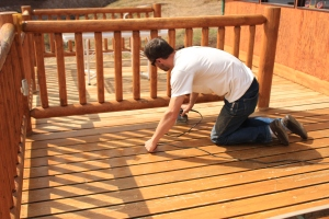 Sanding the deck down.